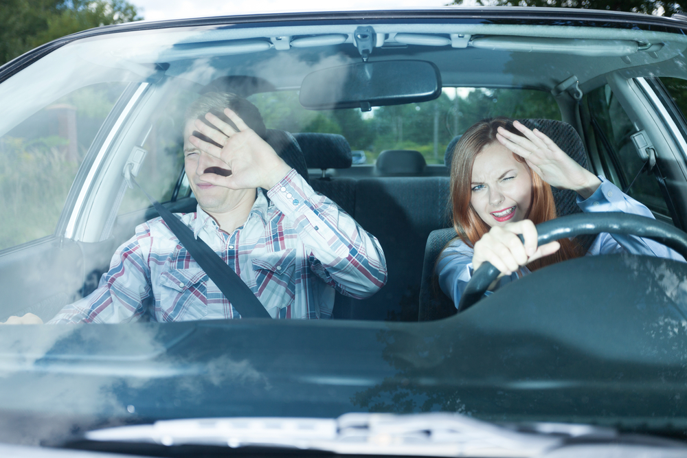 Young couple blinded by high beam headlights