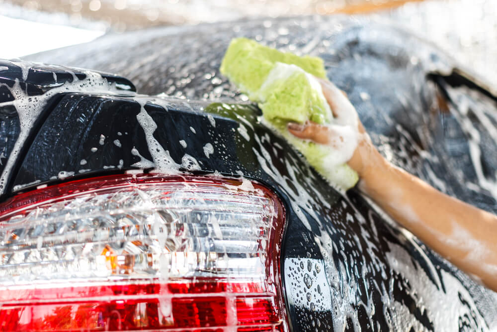 washing a car with soap and sponge